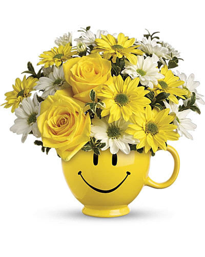 There are probably a million reasons this is such a popular bouquet. Of course, there are probably just as many reasons to send this cheerful arrangement. Full of happy flowers, this ceramic happy face mug will bring smiles for years to come. Especially when filled with that first cup of morning coffee or cocoa!