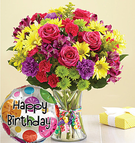 """It's Your Day Bouquet® Happy Birthday Get their birthday party started with a big bunch of smiles! Our bright & colorful bouquet of fresh carnations, daisy poms and more—complete with a festive """"Happy Birthday"""" balloon—lets them know it's their day to shine."""