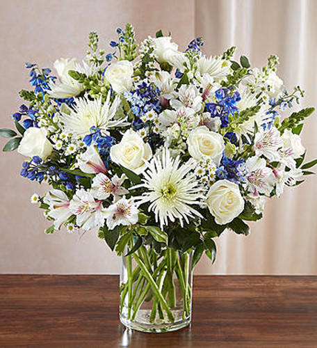 Sincerest Sorrow™ Blue & White A sincerity of sentiment means so much to those grieving. Our bountiful, heavenly blue and white bouquet features a soothing mix of blue delphinium, alstroemeria, and white roses, hand-designed inside a classic clear glass vase. When sent to a service or to the home of family or friends, it makes a genuinely heartwarming gesture.