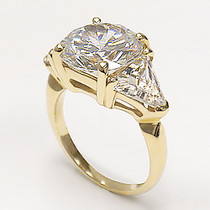Round Center Three Stone Cubic Zirconia Trillion Ring