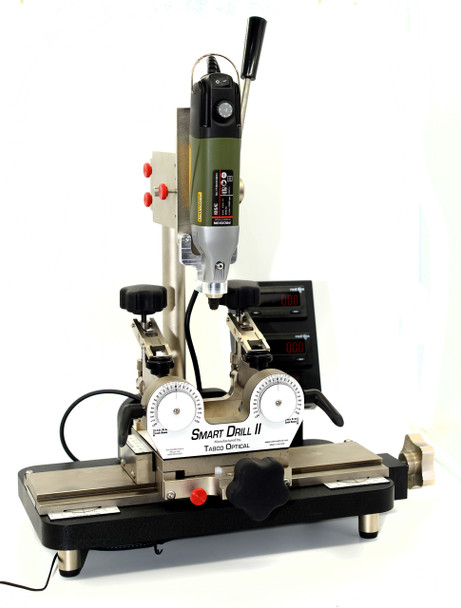 Smart Drill II with complete NEW Digital electronics package: Counters, Encoders, Scales, Box and Wiring same as used on the current Smart Drill III v3.  Starting with a Smart Drill II trade-in we completely dismantle the entire machine clean it, replace non-functioning, worn or bent parts then replaced all glide materials in drill press and lens table.  This machine shows cosmetic worn and use.  We added important updates to improve function including the front support bracket, lens table position lock, etc.  Reassembled, align and test the Smart Drill.  This machine can provide excellent value without buying a new Smart Drill III, please note this machine has been used and has cosmetic damage.  Please note we do not repaint and or replate parts for appearance.  We sell the machines as complete systems along with the Smart Drill we include setup to your blocking system, Ten count package of assorted drill bits, our K4000 and K4100 Rimless Repair Kits, CD with Rimless Drilling formula Charts, Axis alignment bar and Packaging and Shipping to any US address.   Specification for this Refurbished Smart Drill II comes with newest model most advanced Smart Drill counter system.  This system makes manual rimless lens drilling easy with digital readout for processing all types of three-piece mountings.  Digital counters with 0.04 mm accuracy provide the most precise measurements in the industry.  Very little training required.  Most rimless jobs can be drilled in about two minutes! Complete system including supplies and setup for your blocking system.  Shipping to any US & Canada location included.  Features:  - New enhanced digital display - 0.04mm Accuracy for easy read-out repeatability - Adapts to all edger blocking system with lens arms adjustable for edger axis - Variable speed motor 3,000 to 20,000 RPM with Tabco's Precision drill collet - Lens Table designed for quick operation - Lens Table & Drill Press lock for shaped operations on Flair frames  Complete Drilling Package: - Every machine configured to customer edger blocking system - Drill charts; our complete library of drilling coordinates on a CD and six months updates w/ email and phone support - Drill bits;10 pieces of our most used drill bits or customer selected assortment (t1320.xxx) - Rimless Repair Kits; all the parts needed to get started (K4000) and K4100 - Tabco's Axis alignment tool (76911)  Delivery please allow 1-2 weeks for order processing