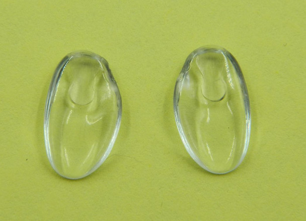 "Image of a pair of NP653 nose pads Replacement Silhouette nose pads made from Premium grade semi-soft and flexible PVC this nose pad measures about 13mm long by 7.5mm wide and 2.2mm think Shape is ""D"" fit there are Left and Right side pads. The mount is a unique Silhouette design using wire bent into a teardrop shape. The bent wire is inserted into the top end of the nose pad. These nose pads were designed to replace the original Silhouette nose pads that are very hard.  This product also fits some Adidas frames a Silhouette line. Packaged and sold 10 pair bags."