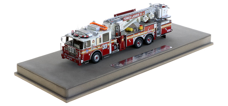 FDNY Tower Ladder 33 includes a fully custom display case.