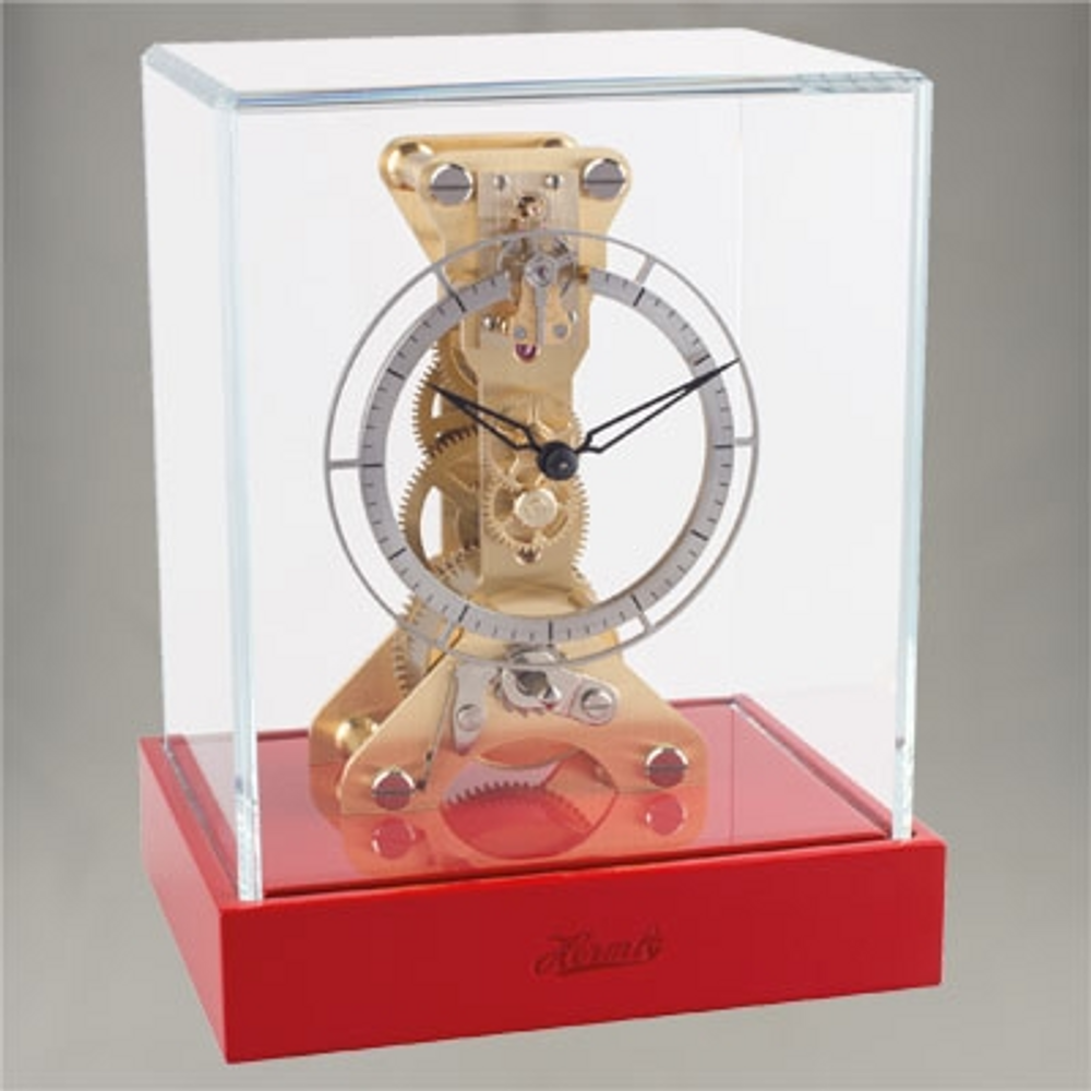 Hermle 8 Day Coral Red finished timber mantle clock.