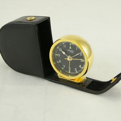Jaccard Quartz Gold Plated alarm travel clock with leather case.