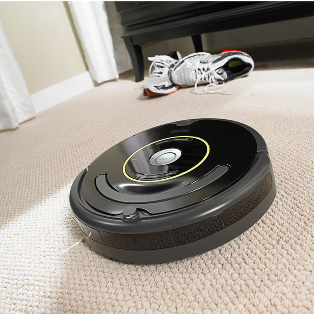 Refurbished: iRobot R Roomba Vacuum Cleaning Robot - Black and White. Features: Robotic vacuum cleaner for carpets and hard floors Roomba does the vacuuming for you, handling dirt, dust, pet hair, lint and even carpet fuzz. Virtual Wall technology emits an infrared beam, limiting Roomba to where you want it.