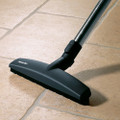 """12"""" floor brush with wheels on both sides for gentle cleaning."""