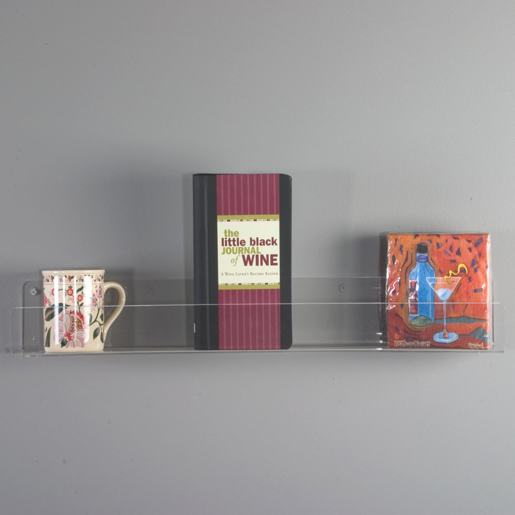 This flat bottom shelf made from high quality polished acrylic displays your merchandise simply and with strength while maximizing your retail space.