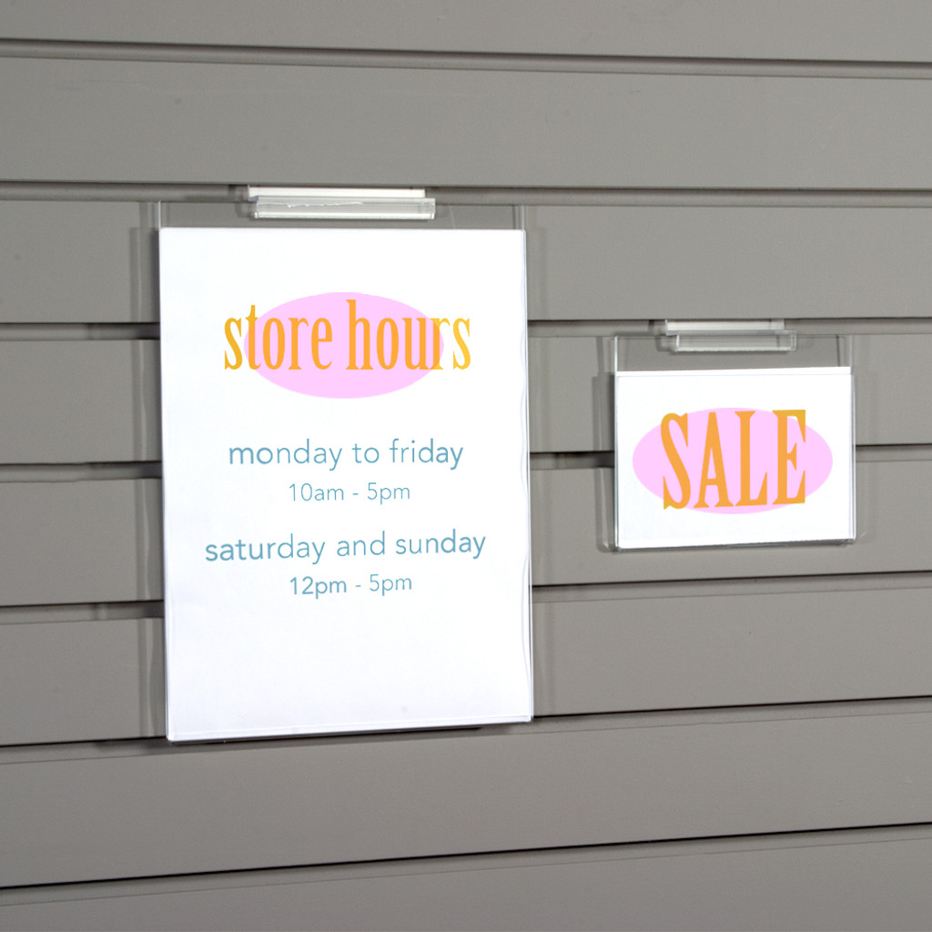 Clear acrylic sign holders for slatwall.