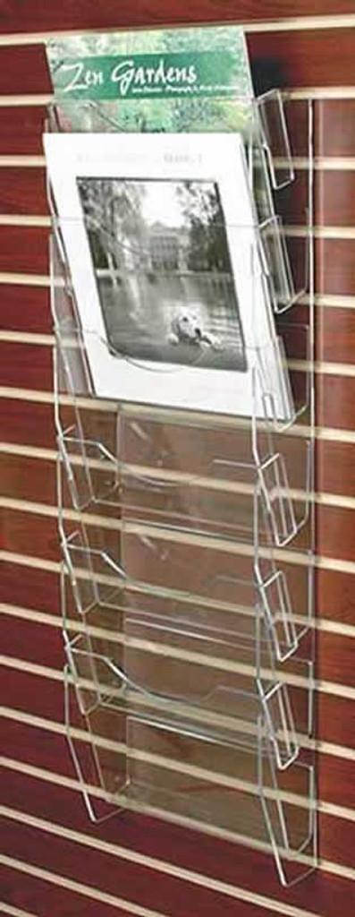 Clear acrylic slatwall mounted calendar rack with six pockets.
