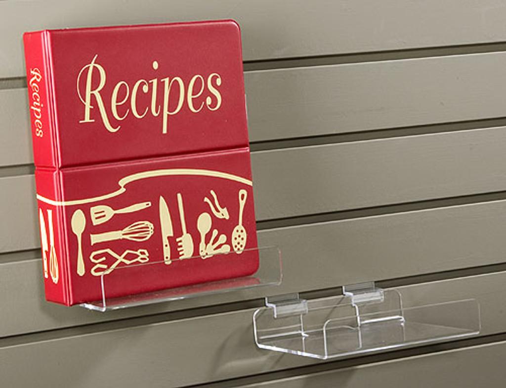 Clear acrylic slatwall display shelf.