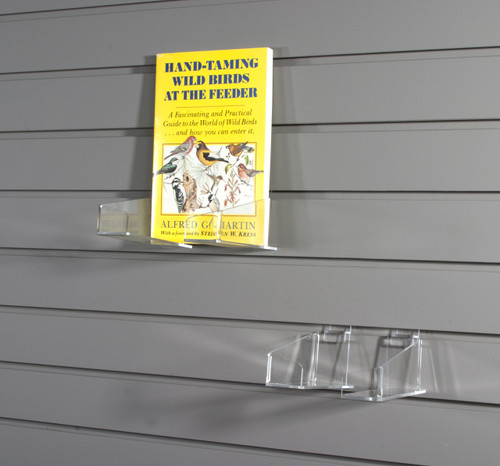 These clear acrylic shelf brackets are movable depending an the size of the item you want to display.