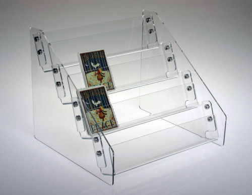 Clear acrylic four-tiered countertop rack sized for small notecards or mini books.