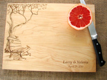 Engraved cutting board with tree, bench and birds design from TheCuttingBoardShop