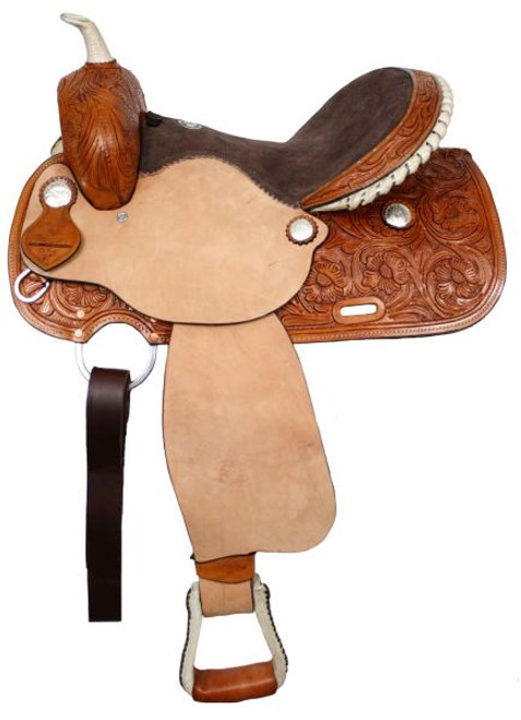 Double T  Barrel style saddle. This saddle features floral tooling on skirts, pommel and cantle. Rough out fenders and jockeys and is accented with braided rawhide horn and silver laced rawhide cantle.