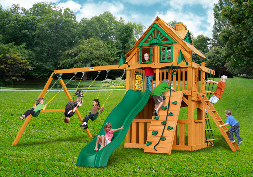 Outdoor shot of Chateau Clubhouse Playset from Gorilla Playsets