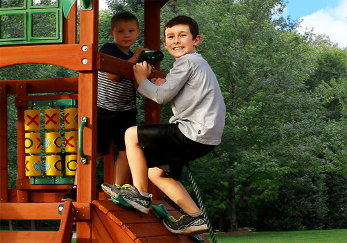 Kids playing on the Hemisphere II from Gorilla Playsets