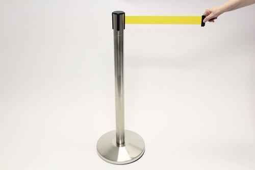Blockade Retractable Belt Tape Barrier- Brushed Steel Post and Yellow Belt Tape (Indoors)
