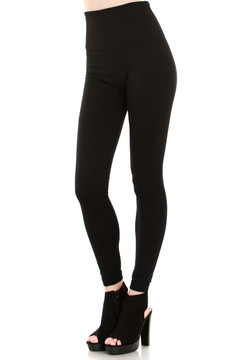 45 degree image of our Black Banded High Waisted Fleece Lined Leggings showing the ribbed high waisted fabric waist band and full length black fleece legging