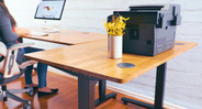 Build your L-shaped workstation complete with a height-adjustable main desk and a fixed-height side table