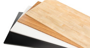 """Choose your own desktop, with solid Rubberwood, 1"""" thick Bamboo, or black and white Eco styles."""