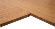 Close up of the inside corner on the L-Shaped Bamboo Desk, featuring beautiful, carbonized bamboo