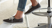 A height-adjustable footrest supports your feet and provides for better circulation