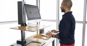 The E7 Electric Standing Desk Converter: Customizable, Adaptable, and Now Available for Pre-Order!