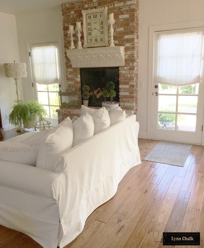 Kravet 3586-1116 Relaxed Roman Shades Sheer Linen Stripe on Living Room French Doors