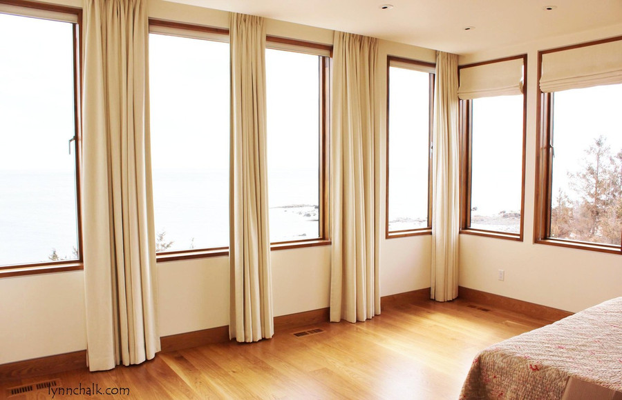 Custom Drapes and Roman Shades by Lynn Chalk for Master Bedroom in Beachfront home in Connecticut (Designed by Julie Schaffer -Salles Schaffer Architecture)