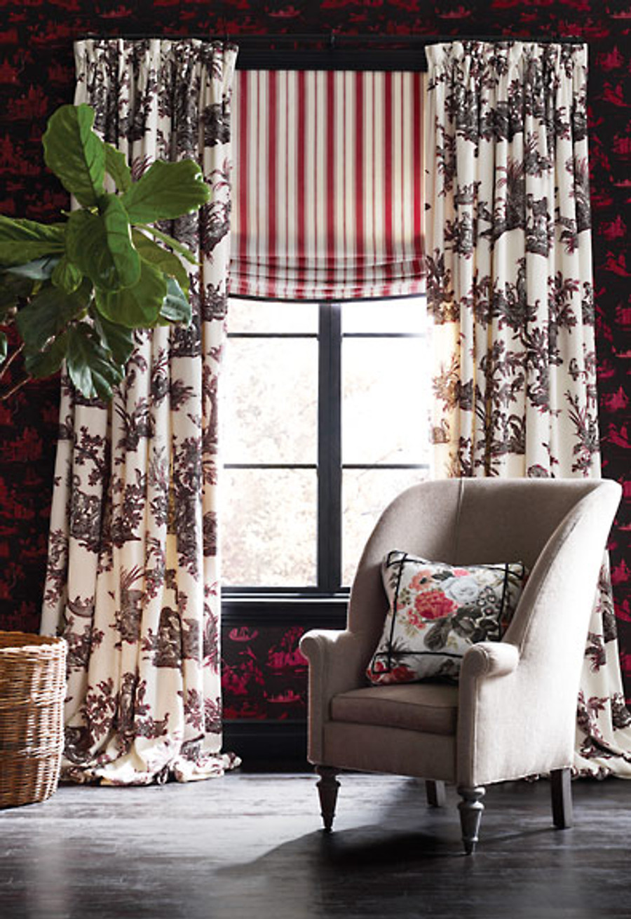 Alessandra Branca Continenti Noir/Rouge on Drapes, Branca Stripe in Rouge on Shade and Elizabeth Rouge/Grey on Pillow on Chair.  Chair is in Sophia Diamond.  Wall is Coromandel Rouge/Noir.