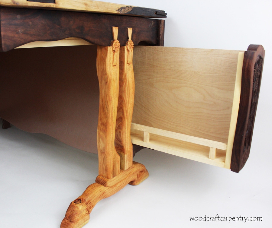 Hidden Drawer pulls out from side and extends along the back of the desk.