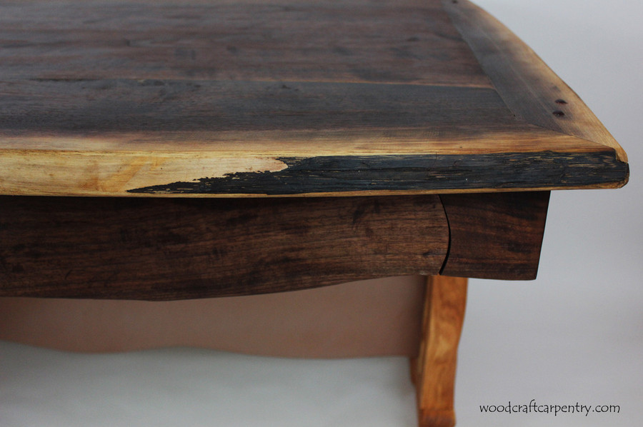Desk has live edge.  Top drawer has curved edges.