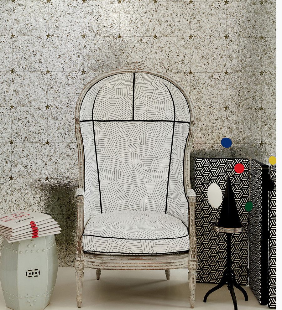 Chair in Deconstructed Stripe in Black.  Panel to right of chair is covered in Tumbling Blocks.