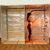 Insert the radiant partition panel in the middle of the sauna tent to enjoy a standing post workout sauna session.