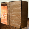 Sauna Fix Hot Yoga and Exercise tent sauna system assembled for use in sitting position, side angle view.