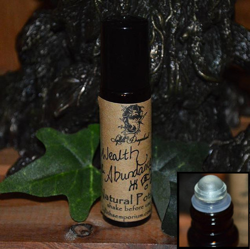 Wealth & Abundance Potion has been created to bring money, prosperity, abundance and success into your life. This Potion can be used to annoint candles, cash registers, wallets, money boxes and even money as part of money spells or as a spell in its' own right. Wear to open yourself to receiving wealth.