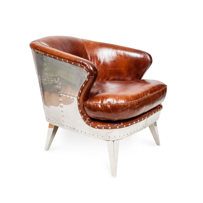Aviator Leather Armchair - Striking industrial steam punk inspired brown aged leather armchair with aluminium sheeting and rivets. Settle in and relax, taking advantage of the wide deeply cushioned seat, curved back and premium vintage leather. Three quarter view right.