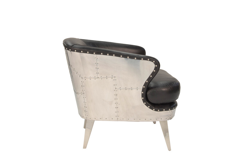 Aviator Leather Armchair - Striking industrial steam punk inspired black aged leather armchair with aluminium sheeting and rivets. Settle in and relax, taking advantage of the wide deeply cushioned seat, curved back and premium vintage leather. Side view.
