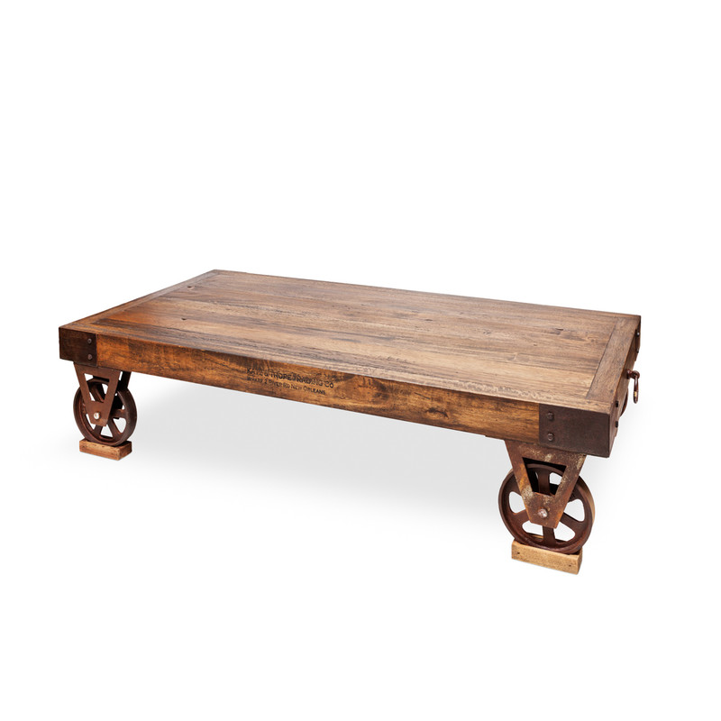 Railway Coffee Table - add some industrial edge with this hand crafted rustic timber coffee table with metal corner detail. With aged metal wheels as a nod to early 1900s craftsmanship, our timber Railway coffee table features metal accents and dove tail joins. The perfect industrial or Country Farmhouse accent. Three quarter view.