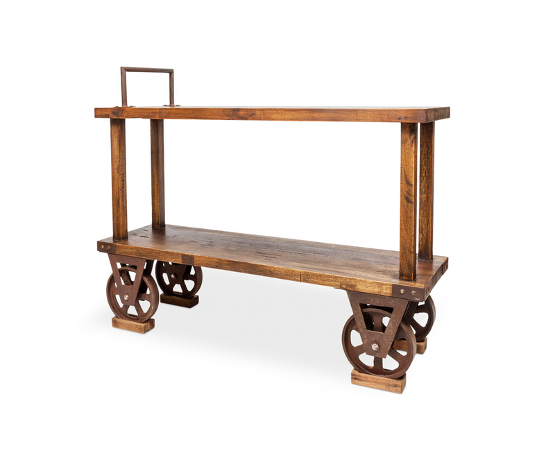 Railway Console - add some industrial edge with this hand crafted rustic timber console table. With aged metal wheels as a nod to early 1900s craftsmanship, our reclaimed walnut console has an open shelf to store the essentials, together with a metal feature handle, wheels, metal accents and dove tail joins. The perfect industrial or Country Farmhouse accent. Three quarter view - right.
