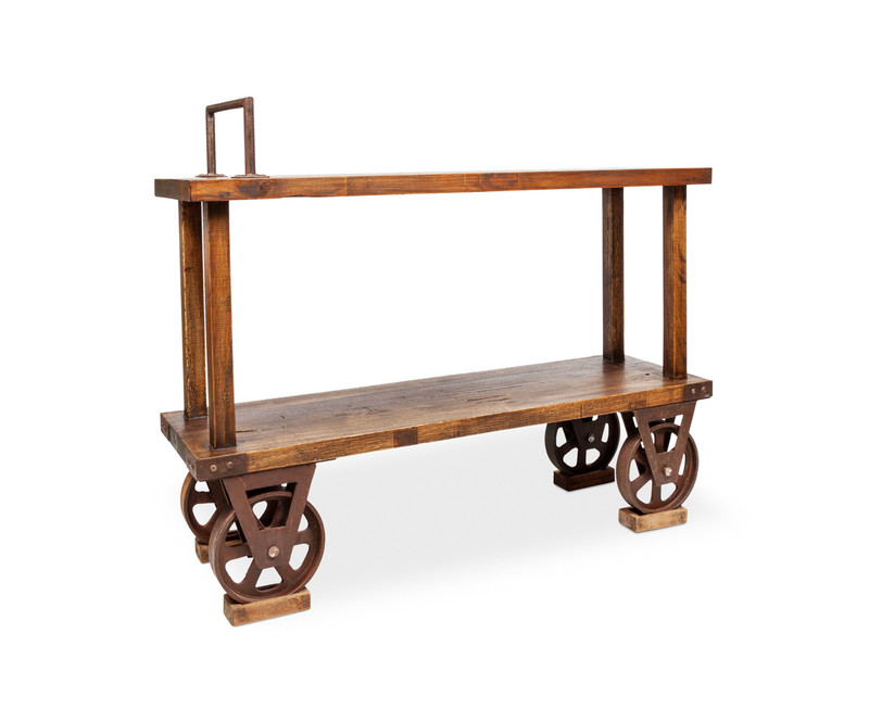 Railway Console - add some industrial edge with this hand crafted rustic timber console table. With aged metal wheels as a nod to early 1900s craftsmanship, our reclaimed walnut console has an open shelf to store the essentials, together with a metal feature handle, wheels, metal accents and dove tail joins. The perfect industrial or Country Farmhouse accent. Three quarter view - left.