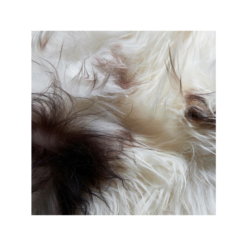 Icelandic Sheepskin Brown Spot. Add warmth, texture and luxury to your space with this naturally silky soft long haired Icelandic Merino sheepskin throw rug brown spot. Detail view.