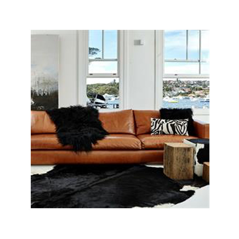Icelandic Sheepskin Black Brown. Add warmth, texture and luxury to your space with this naturally silky soft Icelandic sheepskin throw rug in black brown. Styled view.