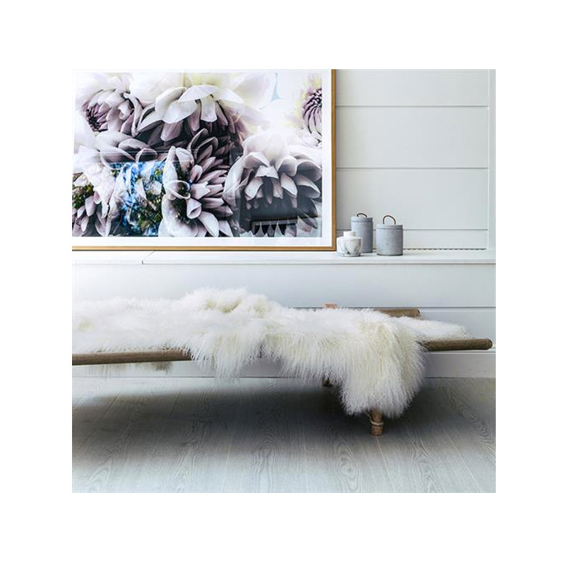 Mongolian Sheepskin Throw White. Add warmth, texture and luxury to your space with this naturally silky soft sheepskin throw rug in white. Style view.