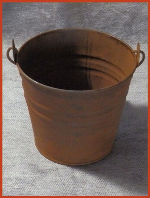 Rusty Metal Pail with Wood Handle