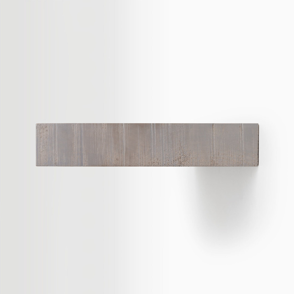 Side edge of our rough cut hatch grey floating shelf. The hardware is easy to install on most wall treatments and is completely hidden in the shelf.
