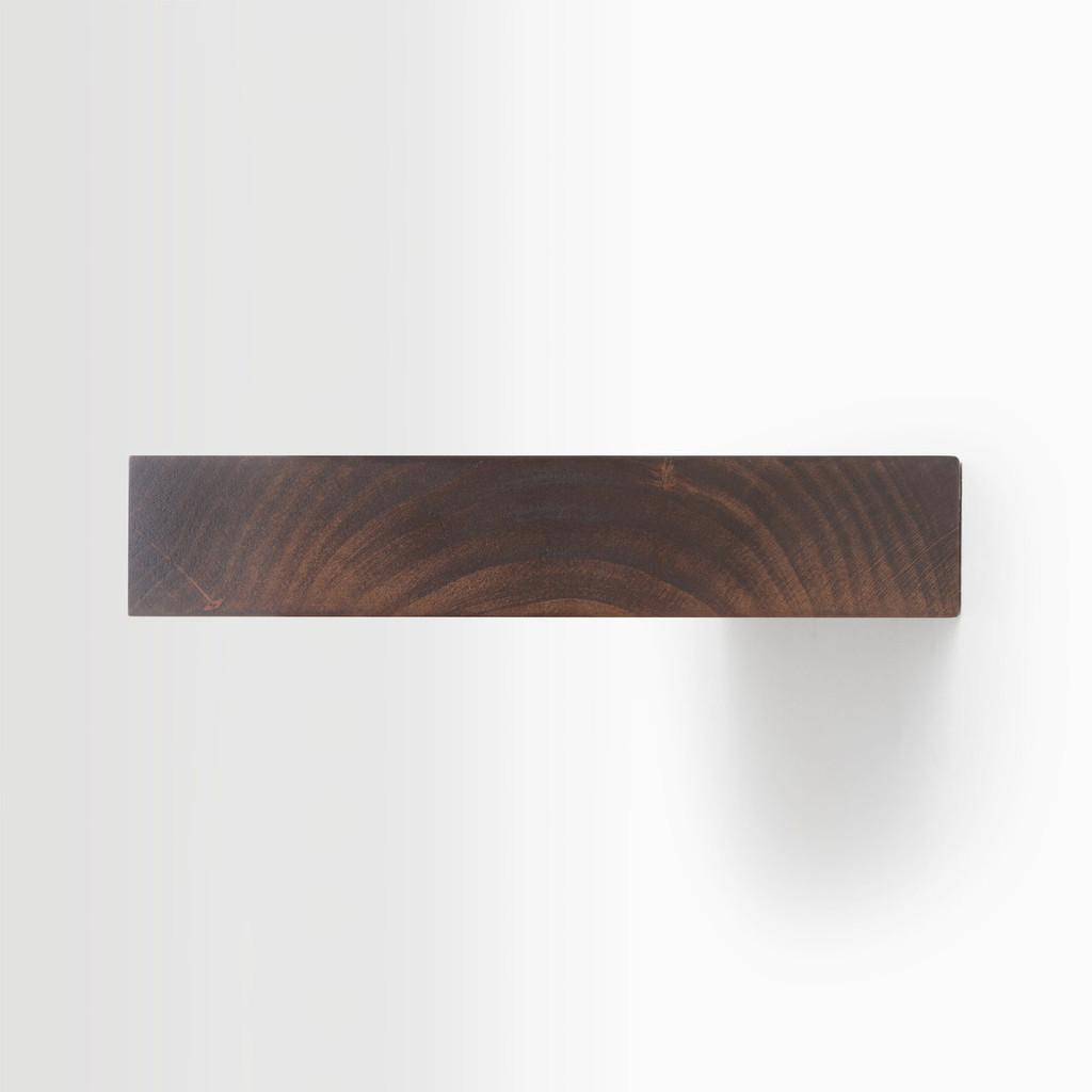 Side edge of our espresso finished alder floating shelf. The hardware is easy to install on most wall treatments and is completely hidden in the shelf.