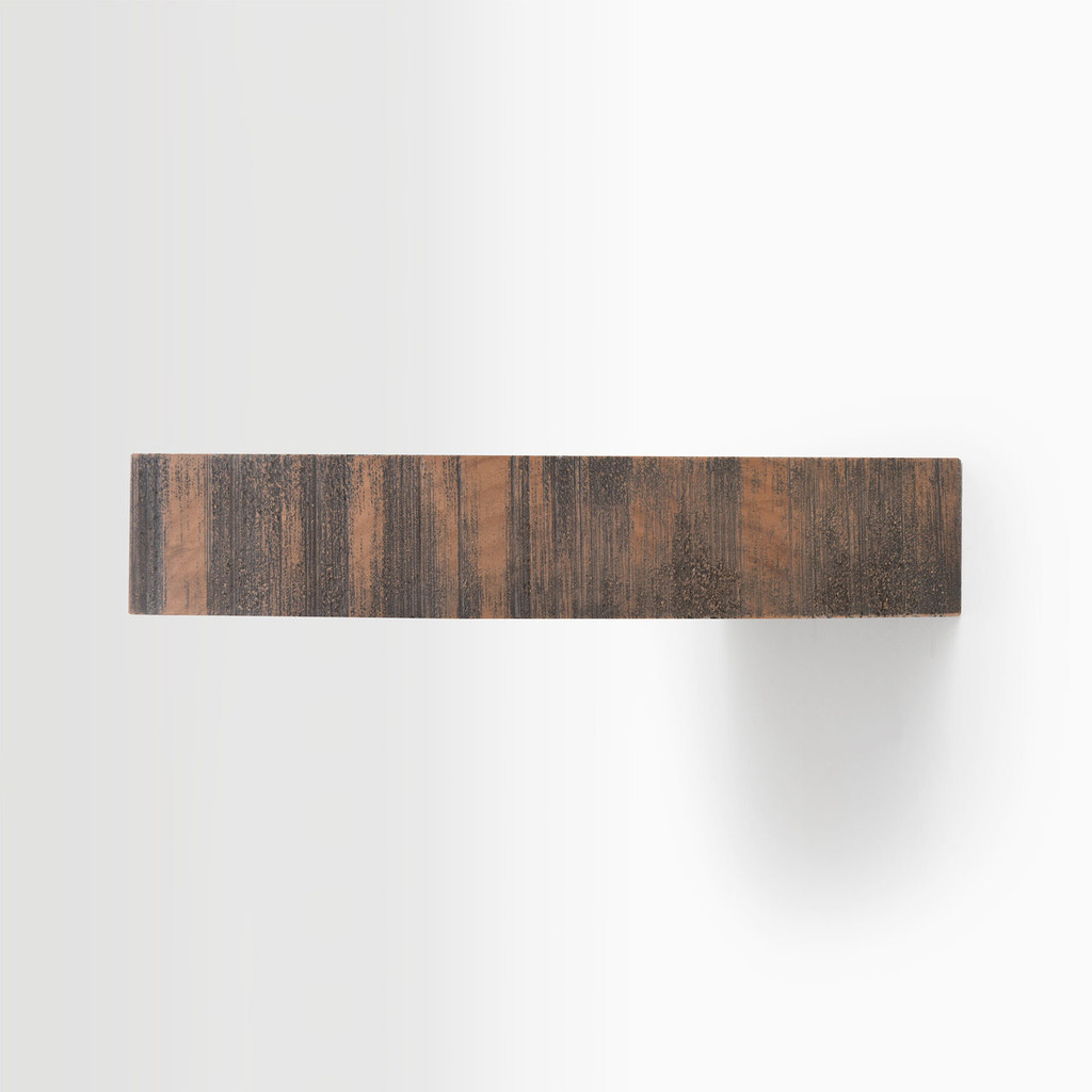 Side edge of our rough cut nutmeg floating shelf. The hardware is easy to install on most wall treatments and is completely hidden in the shelf.