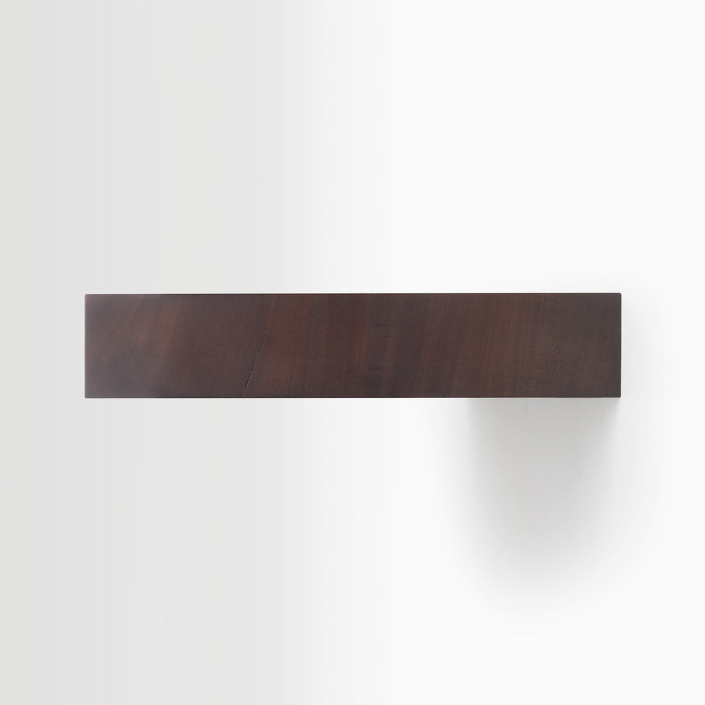 Side edge of our dutch mocha floating shelf. The hardware is easy to install on most wall treatments and is completely hidden in the shelf.